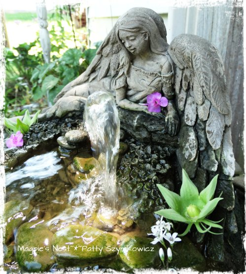 Angel Fountain with a ray of sun