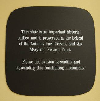 Hotel Monaco marble staircase sign