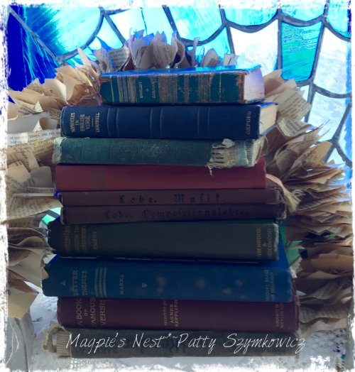 small stack of old books and garland